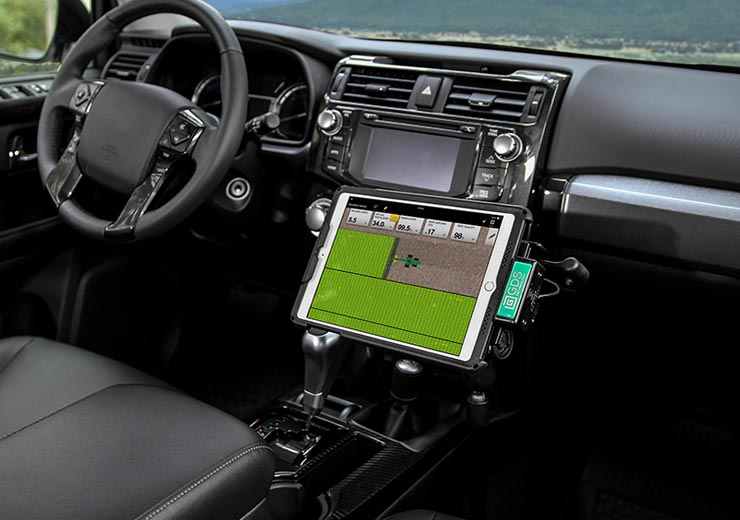 Tablet with IntelliSkin® and GDS® charging dock mounted in vehicle