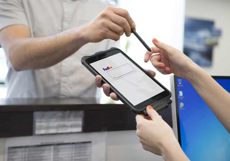 IntelliSkin® with a tablet in hand