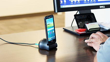 Samsung phone on GDS dock at desk
