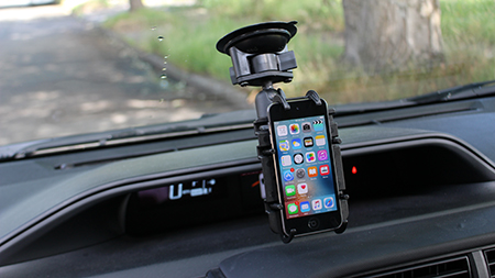 iPhone in Quick-Grip mounted to a windshield with suction cup