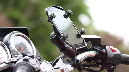 Samsung phone in X-Grip mounted to motorcycle