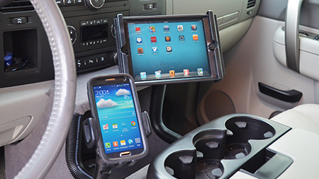 samsung phone and iPad mounted in vehicle