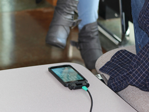 Phone in Intelliskin charging by Snap-Con